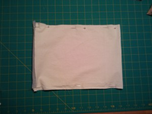 Pin and sew along the long ends of the pillow