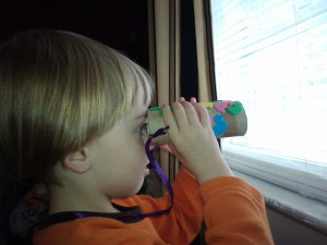 Looking out the window with binoculars